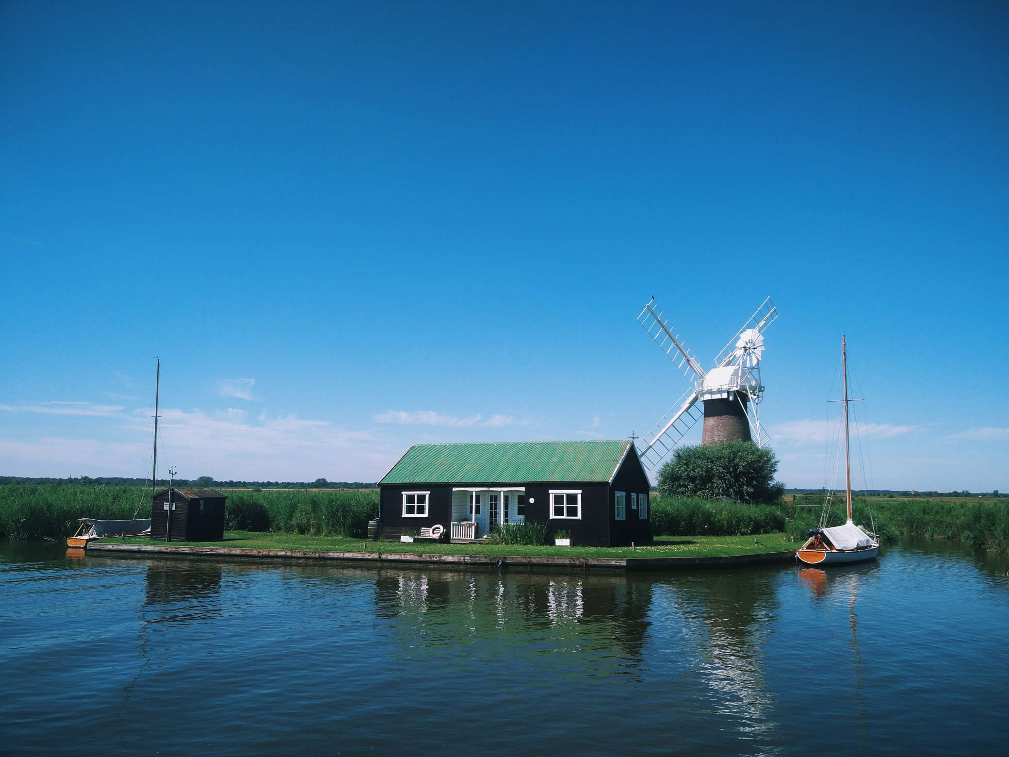 windmill and house on the broads